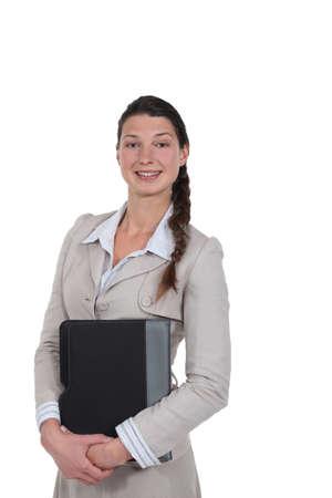 Stylish woman holding a folder photo