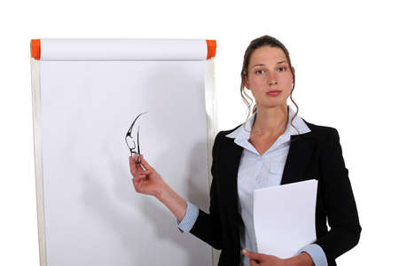 Businesswoman stood in front of flip chart photo