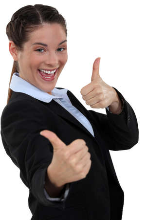 Businesswoman giving two thumb photo