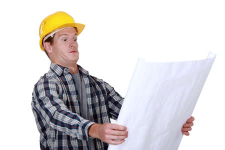 confound: craftsman holding a blueprint and looking very surprised