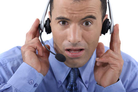 Call centre operator looking shocked photo