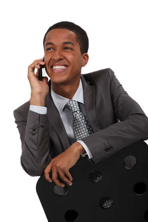 Smiling businessman talking on the phone Stock Photo - 15391596