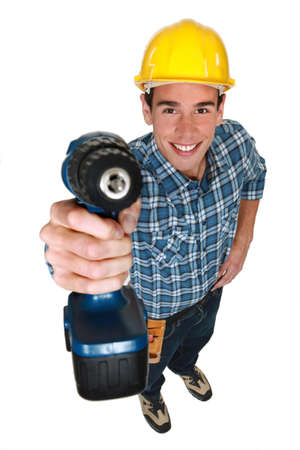 Tradesman holding a power tool Stock Photo