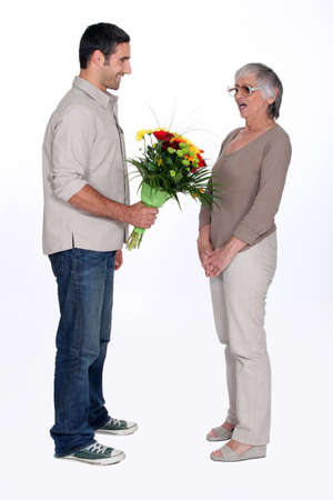 35 years: Son giving mother flowers
