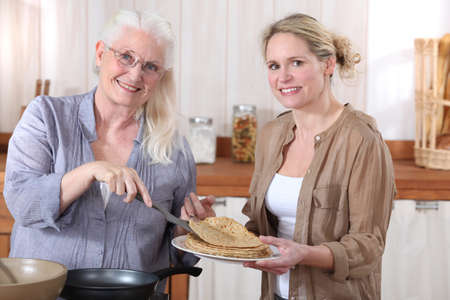 70 75 years: Women making crepes