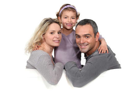 35 40: portrait of couple with daughter against studio background