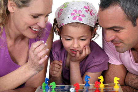 Young family playing a board game photo