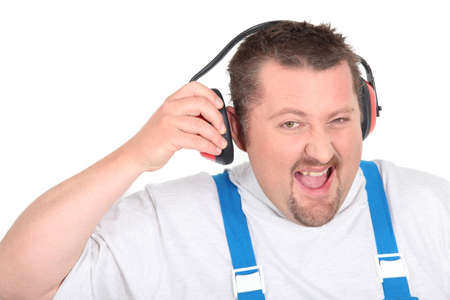 ear protection: Workman disturbed by noise Stock Photo