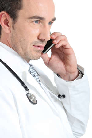Doctor on phone smiling Stock Photo - 15411163