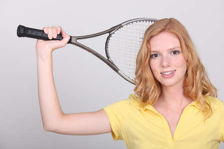 potrait of a woman with tennis racket photo