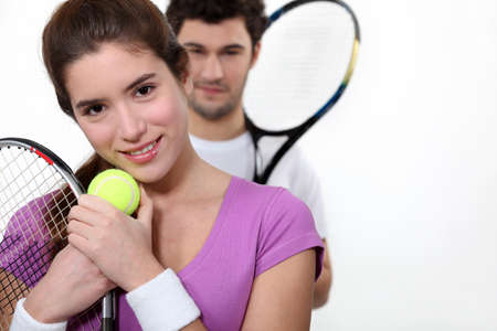 Couple dressed for tennis photo