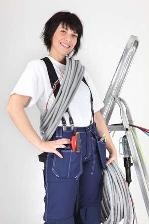 workwoman: Woman holding corrugated tubing