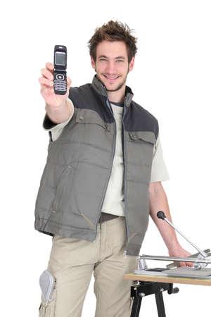 Tiler asking people to call him Stock Photo - 15409215