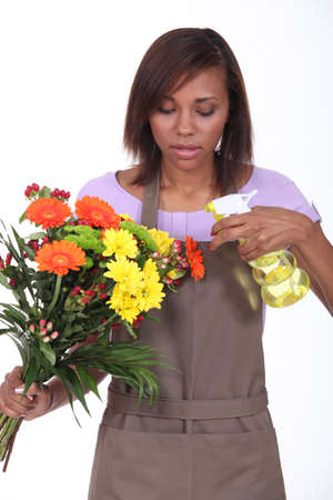 Young woman florist on white background photo