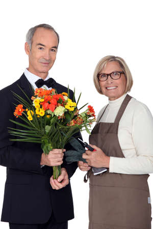Portrait of a florist and a man wearing a tuxedo photo