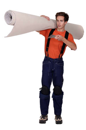 Man carrying roll of carpet photo
