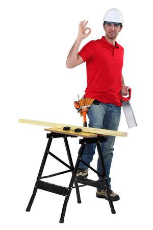 gimmick: Sawing wood Stock Photo