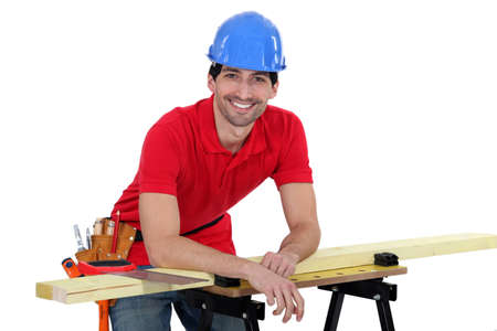 all smiles: portrait of dishy carpenter all smiles