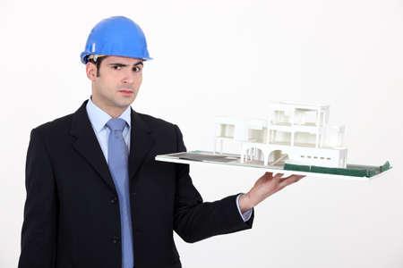 indecisiveness: Architect unsure about a building model