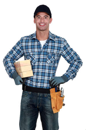 overseer: Smiling manual worker with wood Stock Photo