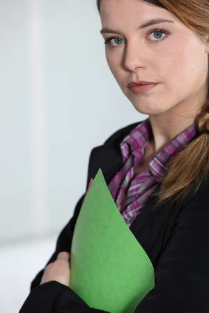 sales manager: Young businesswoman with file.