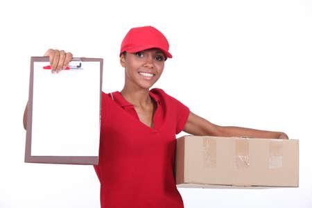 Delivery woman. Reklamní fotografie