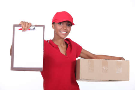 deliver: Delivery woman. Stock Photo