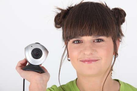 web cam: girl holding a web cam