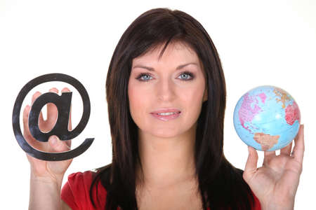 arobase: Woman holding globe and at symbol