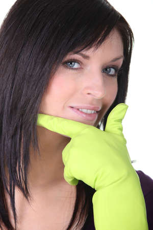 dish washing gloves: Closeup of a woman wearing household rubber gloves