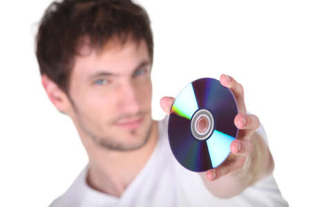 Young man showing CD, studio shot Stock Photo - 15410095