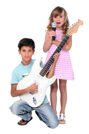 boy playing guitar: Young musicians Stock Photo