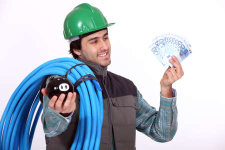 Plumber holding his wages photo