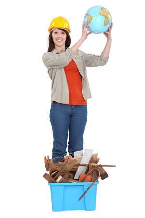 craftswoman: craftswoman raising a globe