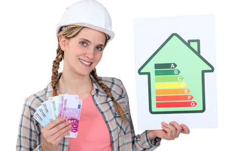 Woman holding cash and energy rating card photo