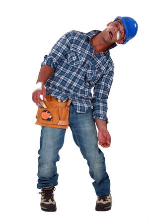 precarious: Tradesman suffering from a work-related injury Stock Photo