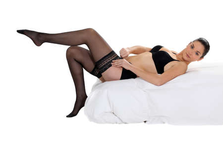 nylons: woman putting on black stockings