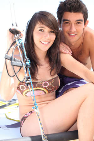 Portrait of a young man and a young woman in swimsuit photo