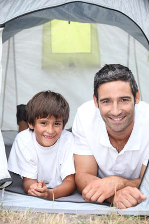 father and son at camping photo