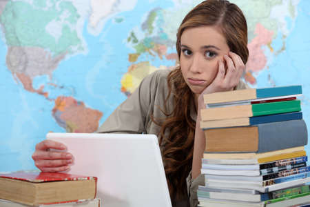 unsatisfied: girl studying at her desk Stock Photo