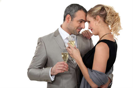 formal dress: Couple dancing with glasses of champagne Stock Photo