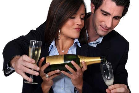 celebratory: Couple celebrating with a glass of wine