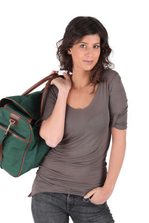 holdall: Young woman with green holdall