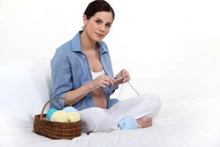naked belly: Pregnant woman knitting