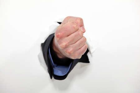 break through: Fist emerging from wall