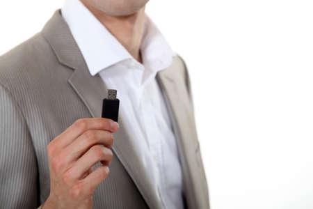 mb: Businessman holding USB key