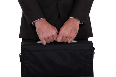 Businessman holding his briefcase photo