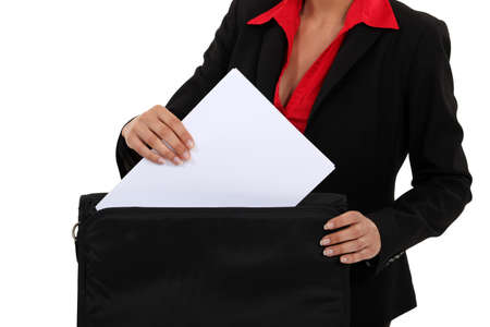 lacking: Woman holding portfolio Stock Photo