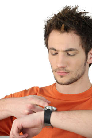 Man tapping his watch Stock Photo - 15410170
