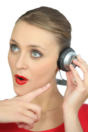 Surprised woman wearing headphones photo